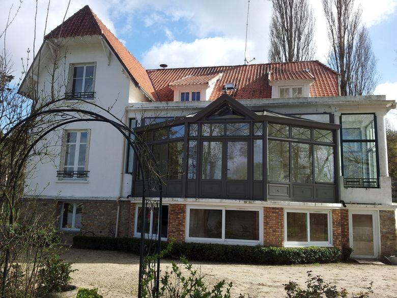 Een orangerie uitbreiding in landelijke stijl
