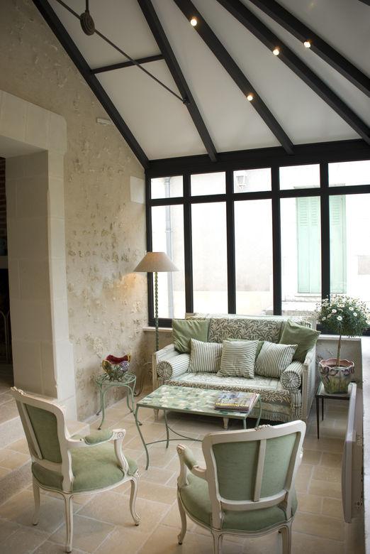 Een veranda in landelijke orangerie stijl